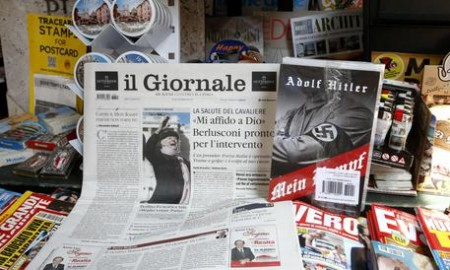 "Il Giornale newspaper is seen on sale in a newsstand with Hitler's ""Mein Kampf"", in Rome Saturday, June 11, 2016. The conservative Milan daily Il Giornale  has published Hitlers political manifesto Mein Kampf, angering Italys premier and the tiny Jewish community. (ANSA/AP Photo/Fabio Frustaci)"