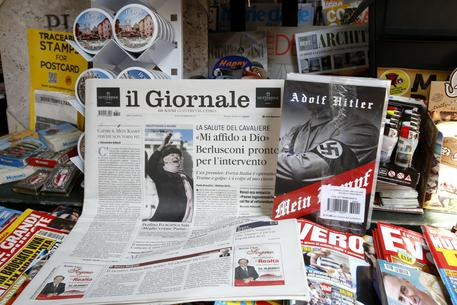 """Il Giornale newspaper is seen on sale in a newsstand with Hitler's """"Mein Kampf"""", in Rome Saturday, June 11, 2016. The conservative Milan daily Il Giornale  has published Hitlers political manifesto Mein Kampf, angering Italys premier and the tiny Jewish community. (ANSA/AP Photo/Fabio Frustaci)"""